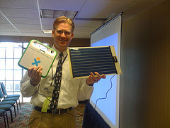 Moving at the Speed of Creativity - Wesley Fryer with a XO Laptop and Solar Charger